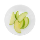 Green apple slices on a plate top view Stock Images