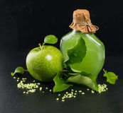 Green apple with spa and aromatherapy accessories Stock Photos