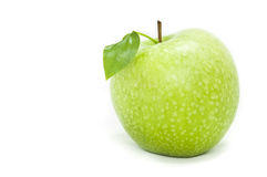 Green apple in a speck on a white background Royalty Free Stock Images