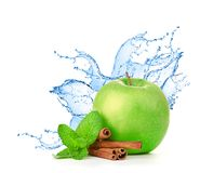 Green apple in splash of water isolated Royalty Free Stock Image
