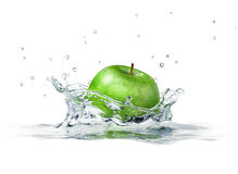 Green apple splashing into water. Close up side view, with depth of field. 3 D digital rendering, on white background royalty free stock photography