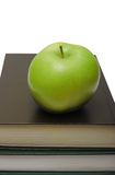 Green apple on stack of book Royalty Free Stock Images