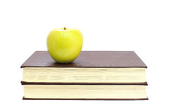 Green apple on stack of book isolated Stock Image