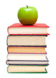 Green apple on stack of books Stock Image