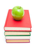 Green apple on stack of books Royalty Free Stock Images