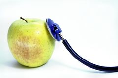 Green apple and stethoscope Royalty Free Stock Photo