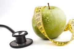 Green Apple with Stethoscope Stock Photography