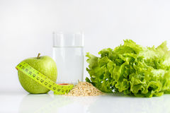 Green apple still water and lettuce. Green apple, tape-line, still water and lettuce Royalty Free Stock Images