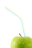 Green apple with straw. Isolated Stock Images