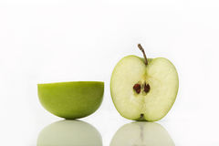 Green apple. Studio shot of green apple cut in half showing seeds royalty free stock image