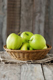 Green apple. Sweet green apple on the wooden table, selective focus Stock Photo