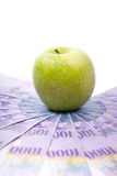 Green apple on Swiss francs banknotes  spreaded over the floor - Royalty Free Stock Images