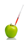 Green apple and syringe Royalty Free Stock Photo