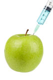 Green apple with syringe inserted Stock Photos