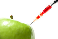 Green apple with syringe Stock Photography