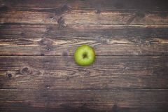 Green apple on the table.  stock photo