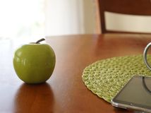 Green apple on table Stock Images