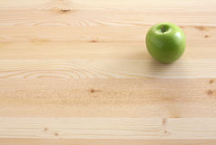 Green apple. On table wood Royalty Free Stock Photography