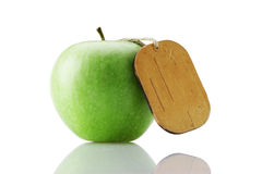 Green apple with tag Stock Image