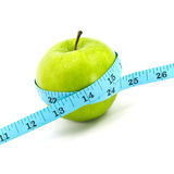 Green apple with tape Royalty Free Stock Photos
