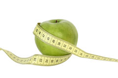 Green apple with tape Royalty Free Stock Photo