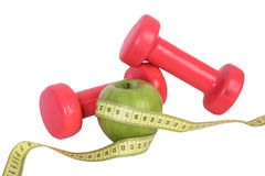 Green apple on tape with dumbbell Royalty Free Stock Image