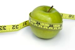 Green Apple with tape line Stock Photo