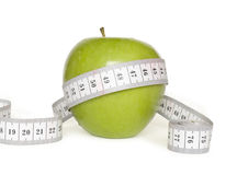 Green apple and tape measure Royalty Free Stock Image