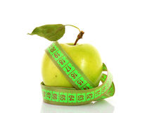 Green apple and tape measure Stock Image