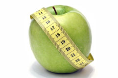 Green apple and tape measure Royalty Free Stock Photography