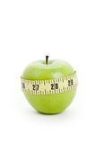 Green apple and Tape Measure Stock Photography