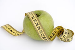 Green apple with tape measure Stock Image