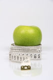 Green Apple and Tape Measure Stock Photo