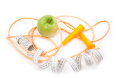 A green apple, tape measure and rope Stock Image