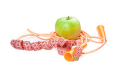A green apple, tape measure and rope Royalty Free Stock Image