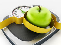 Green apple and tape measure on weight scale Stock Photos