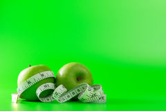 Green apple with a tape measure Stock Image