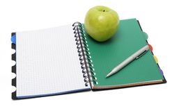 Green apple and Textbook Royalty Free Stock Images