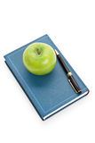 Green apple and Textbook Royalty Free Stock Photography