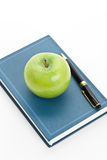Green apple and Textbook Stock Photo