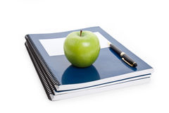 Green apple and Textbook Stock Photos