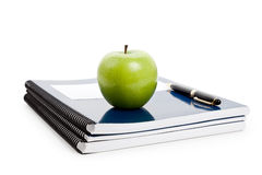 Green apple and Textbook Royalty Free Stock Photo