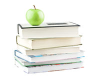 Green apple on textbooks Stock Images