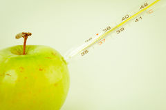 Green apple and thermometer Stock Photo