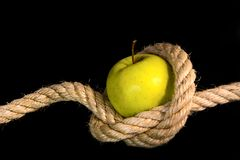 Green apple tided with rope Stock Photo