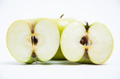 Green apple and two halves Royalty Free Stock Photography