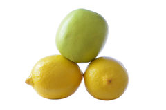 Green apple and two lemons royalty free stock images