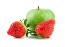 Green apple and two strawberries. Green apple and two strawberries   on a white background Royalty Free Stock Image