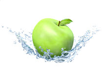 Green apple under water with a trail of transparent bubbles Royalty Free Stock Photography