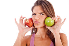 Green apple vs red apple. Happy young woman with two apples on isolated background stock photos